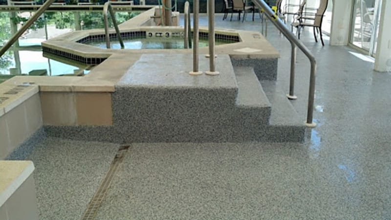 An assisted living community's pool steps has JetRock applied to it.