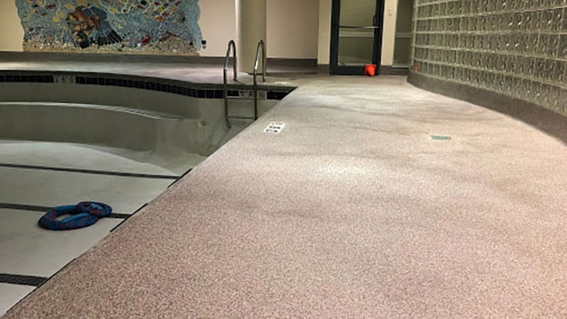 An assisted living community's pool has JetRock flooring applied to its walkways.