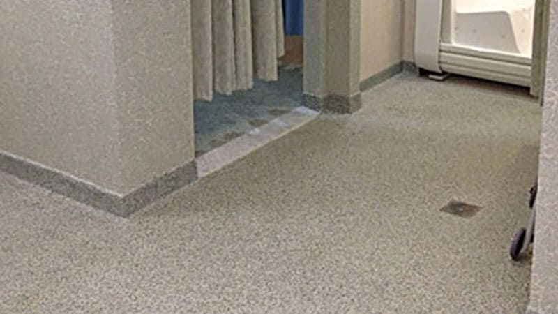 An assisted living community's pool has JetRock epoxy flooring applied to its bathroom and shower floors.
