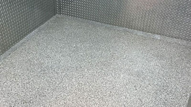 Seamless epoxy flooring in the corner of a room