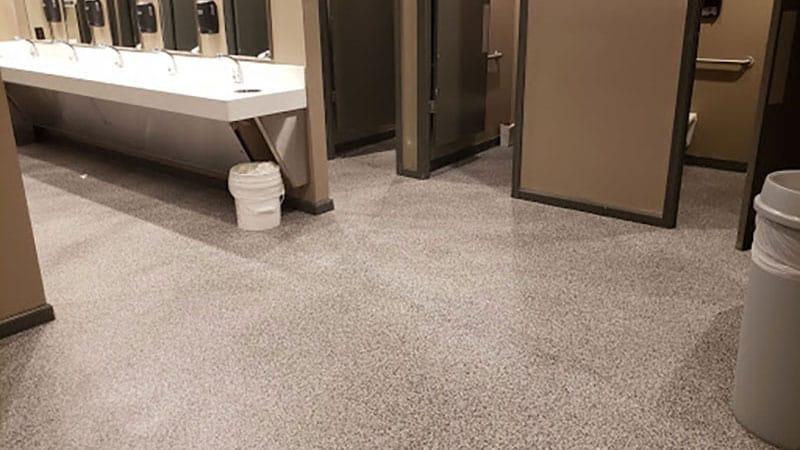JetRock flooring applied to a school bathroom floor