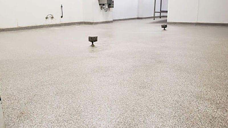 JetRock epoxy flooring applied to a university locker room floor